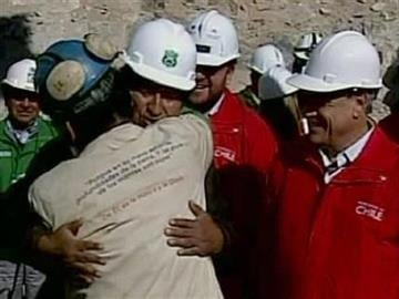 In this screen grab taken from video, Bolivian President Evo Morales, third from left, embraces Jorge Galeguillos, the eleventh miner to be rescued from the San Jose Mine near Copiapo, Chile on Wednesday, Oct. 13, 2010.  (AP Photo) By Afton Spriggs