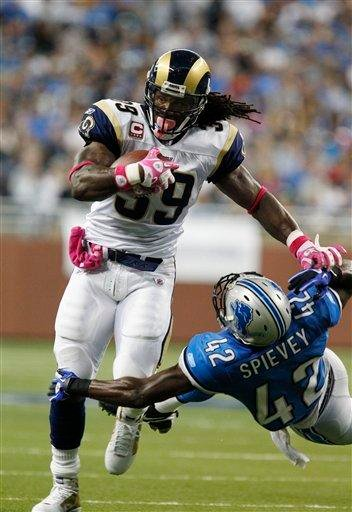 St. Louis Rams running back Steven Jackson (39) runs past Detroit Lions cornerback Amari Spievey (42) during the first quarter of an NFL football game at Ford Field in Detroit, Sunday, Oct. 10, 2010. (AP Photo/Rick Osentoski) By Rick Osentoski