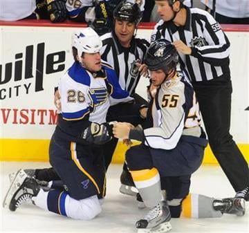 St. Louis Blues' B.J. Crombeen (26) and Nashville Predators' Shane O'Brien (55) get to their feet after a fight in the first period of an NHL hockey game on Thursday, Oct. 14, 2010, in Nashville, Tenn. (AP Photo/Mike Strasinger) By Mike Strasinger