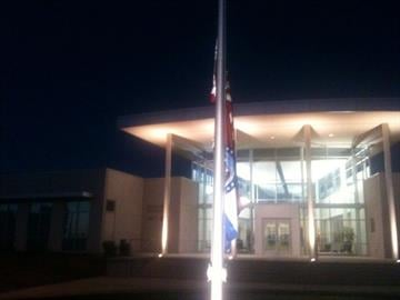 Flags at half staff at Troop C headquarters in memory of Sgt Joseph   Schuengel. By KMOV Web Producer