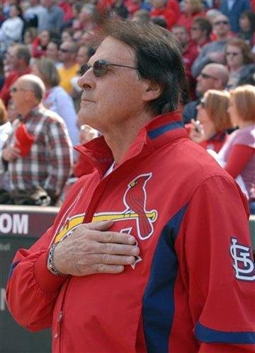 St. Louis Cardinals' manager Tony La Russa stands for the national anthem prior to a baseball game against the Colorado Rockies on Sunday Oct. 3, 2010, in St. Louis. (AP Photo/Bill Boyce) By Bill Boyce