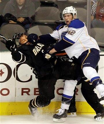 St. Louis Blues' David Backes (42) knocks Dallas Stars' Trevor Daley, left, during the first period of an NHL hockey game in Dallas, Saturday, Oct. 16, 2010. (AP Photo/LM Otero) By LM Otero