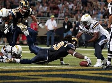 St. Louis Rams running back Steven Jackson (39) scores a touchdown against San Diego Chargers free safety Paul Oliver (27) during the the second quarter of an NFL football game Sunday, Oct. 17, 2010, in St. Louis. (AP Photo/Jeff Roberson) By Jeff Roberson