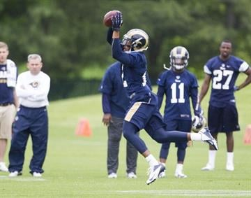 EARTH CITY, MO - MAY 10: Stedman Bailey (12) of the St. Louis Rams makes a leaping catch during the 2013 St. Louis Rams rookie camp at Rams Park on May 10, 2013 in Earth City, Missouri. (Photo by David Welker/Getty Images) By David Welker
