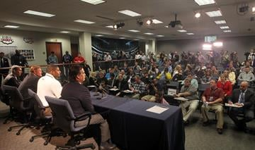 St. Louis Rams rookie Michael Sam (white shirt) meets a room full of reporters at Rams Park in Earth City, Missouri on May 13, 2014. Sam, the first openly gay player was drafted by the Rams in the 2014 draft. UPI/Bill Greenblatt By BILL GREENBLATT