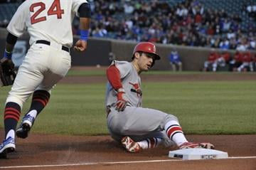 CHICAGO, IL - MAY 04: Randal Grichuk #15 of the St. Louis Cardinals slides safely with a triple against the Chicago Cubs during the second inning on May 4, 2014 at Wrigley Field in Chicago, Illinois. (Photo by David Banks/Getty Images) By David Banks