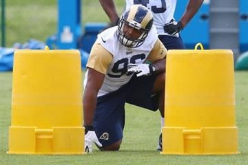 EARTH CITY, MO - MAY 16: Michael Sam #96 of the St. Louis Rams participates in a rookie minicamp at Rams Park on May 16, 2014 in Earth City, Missouri.  (Photo by Dilip Vishwanat/Getty Images) By Dilip Vishwanat
