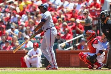 ST. LOUIS, MO - MAY 18: Justin Upton #8 of the Atlanta Braves hits a solo home run against the St. Louis Cardinals in the fourth inning at Busch Stadium on May 18, 2014 in St. Louis, Missouri.  (Photo by Dilip Vishwanat/Getty Images) By Dilip Vishwanat