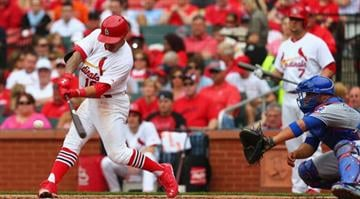 ST. LOUIS, MO - APRIL13: Kolten Wong #16 of the St. Louis Cardinals hits an RBI single against the Chicago Cubs in the second inning at Busch Stadium  on April 13, 2014 in St. Louis, Missouri.  (Photo by Dilip Vishwanat/Getty Images) By Dilip Vishwanat