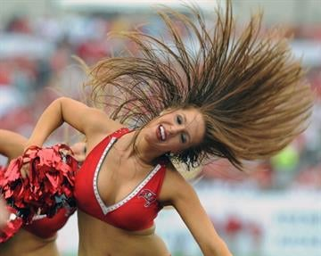 TAMPA, FL - SEPTEMBER 9:  A cheerleader of the Tampa Bay Buccaneers dances during play against the Carolina Panthers at Raymond James Stadium September 9, 2012 in Tampa, Florida.  (Photo by Al Messerschmidt/Getty Images) By Al Messerschmidt