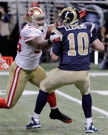 St. Louis Rams quarterback Kellen Clemens, right, is sacked for an 11-yard loss by San Francisco 49ers linebacker Ahmad Brooks during the second quarter of an NFL football game Sunday, Jan. 1, 2012, in St. Louis. (AP Photo/Seth Perlman) By Seth Perlman