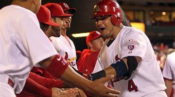 St. Louis Cardinals Yadier Molina celebrates with teammates after hitting a solo home run in the fourth inning against the Houston Astros at Busch Stadium in St. Louis on September 19, 2012.   UPI/Bill Greenblatt By KMOV Web Producer