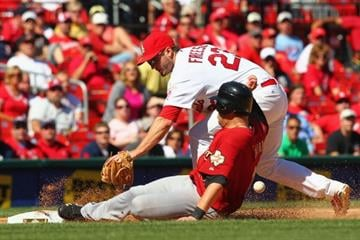 ST. LOUIS, MO - SEPTEMBER 20: David Freese #23 of the St. Louis Cardinals fails to tag out Brandon Laird #13 of the Houston Astros at Busch Stadium on September 20, 2012 in St. Louis, Missouri.  (Photo by Dilip Vishwanat/Getty Images) By Dilip Vishwanat