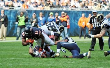 CHICAGO, IL- SEPTEMBER 23:  Michael Bush #29 of the Chicago Bears is tackled by  Jo-Lonn Dunbar #58 of the St. Louis Rams on September 23, 2012 at Soldier Field in Chicago, Illinois.  (Photo by David Banks/Getty Images) By David Banks