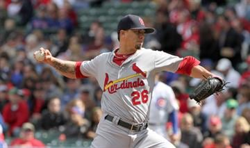CHICAGO, IL - SEPTEMBER 23: Kyle Lohse #26 the St Louis Cardinals  throws against the Chicago Cubs on September 23, 2012 at Wrigley Field in Chicago, Illinois.(Tasos Katopodis/Getty Images) By Tasos Katopodis