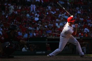 ST. LOUIS, MO - SEPTEMBER 20: David Freese #23 of the St. Louis Cardinals hits a single against the Houston Astros at Busch Stadium on September 20, 2012 in St. Louis, Missouri.  (Photo by Dilip Vishwanat/Getty Images) By Dilip Vishwanat