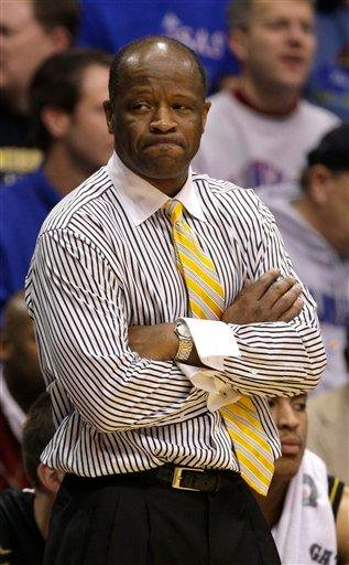 Missouri coach Mike Anderson watches the final moments of an NCAA college basketball game against Kansas on Monday, Jan. 25, 2010, in Lawrence, Kan. Kansas won 84-65. (AP Photo/Charlie Riedel) By Charlie Riedel
