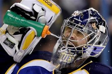 St. Louis Blues goalie Ty Conklin cools off after giving up his second goal during the first period of an NHL hockey game against the San Jose Sharks Thursday, Feb. 4, 2010, in St. Louis. (AP Photo/Jeff Roberson) By Jeff Roberson