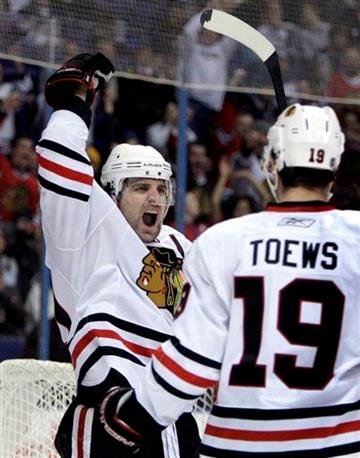 Chicago Blackhawks' Patrick Sharp, left, celebrates along side teammate Jonathan Toews after scoring during the first period of an NHL hockey game against the St. Louis Blues Saturday, Feb. 6, 2010, in St. Louis. (AP Photo/Jeff Roberson) By Jeff Roberson