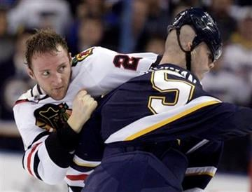 Chicago Blackhawks' Cam Barker, left, and St. Louis Blues' Barret Jackman fight during the first period of an NHL hockey game Saturday, Feb. 6, 2010, in St. Louis. (AP Photo/Jeff Roberson) By Jeff Roberson