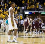 Missouri's Kim English, left, walks off the court as the Texas A&M team celebrates in the background after Texas A&M's 77-74 victory in an NCAA college basketball game Wednesday, Feb. 3, 2010, in Columbia, Mo. (AP photo/L.G. Patterson) By L.G. Patterson