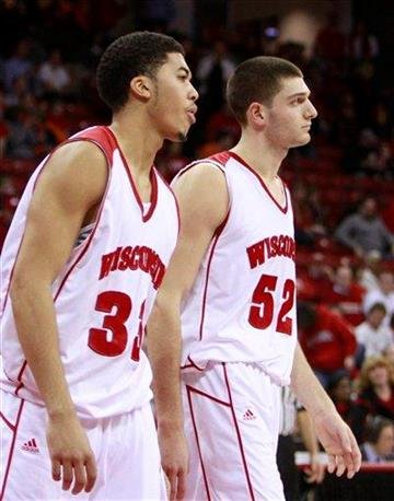 Wisconsin's Rob Wilson, left, and Keaton Nankivil (52) walk off the court after Wisconsin lost to Illinois 63-56 in an NCAA college basketball game Tuesday, Feb. 9, 2010, in Madison, Wis. (AP Photo/Andy Manis) By Andy Manis