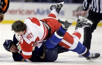 St. Louis Blues' Brad Winchester, bottom, and Detroit Red Wings' Brad May fight during the first period of an NHL hockey game Tuesday, Feb. 9, 2010, in St. Louis. (AP Photo/Jeff Roberson) By Jeff Roberson