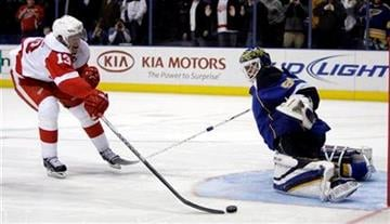Detroit Red Wings' Pavel Datsyuk, of Russia, can't get off a shot as St. Louis Blues goalie Chris Mason defends during a shootout in an NHL hockey game Tuesday, Feb. 9, 2010, in St. Louis. The Blues won 4-3. (AP Photo/Jeff Roberson) By Jeff Roberson