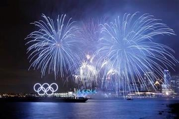 The downtown skyline is seen during the opening ceremonies at the Vancouver 2010 Olympics in Vancouver, British Columbia, Friday, Feb. 12, 2010. (AP Photo/Marcio Sanchez) By Marcio Sanchez