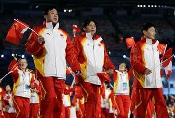 Chinese athletes march in during the opening ceremony for the Vancouver 2010 Olympics in Vancouver, British Columbia, Friday, Feb. 12, 2010. (AP Photo/Gerry Broome) By Gerry Broome