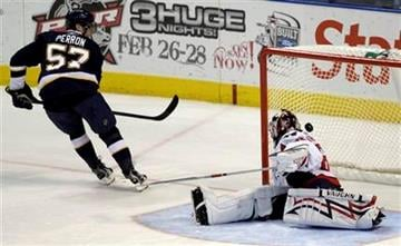 St. Louis Blues' David Perron, left, scores the only goal during the shootout of an NHL hockey game as Washington Capitals goalie Jose Theodore defends on Saturday, Feb. 13, 2010, in St. Louis. The Blues won 4-3. (AP Photo/Jeff Roberson) By Jeff Roberson