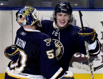 St. Louis Blues goalie Chris Mason, left, and teammate T.J. Oshie celebrate the Blues' 4-3 shootout victory over the Washington Capitals in an NHL hockey game Saturday, Feb. 13, 2010, in St. Louis. (AP Photo/Jeff Roberson) By Jeff Roberson