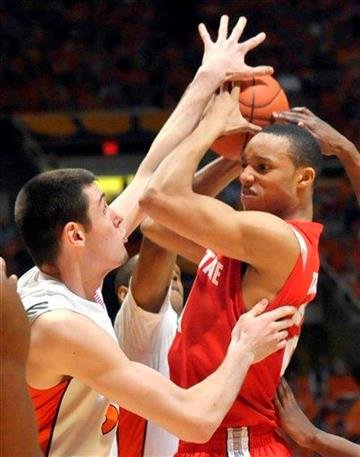 Illinois' Mike Tisdale (54) tries to block a shot by Ohio State's Evan Turner (21) during their NCAA college basketball game at the Assembly Hall in Champaign, Ill., on Sunday, Feb. 14, 2010. (AP Photo/Robin Scholz) By Robin Scholz
