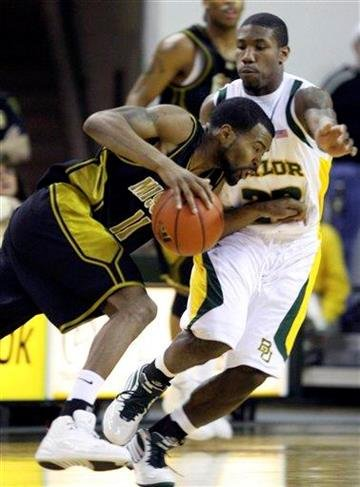 Missouri guard Zaire Taylor (11) drives against Baylor's A.J. Walton (22) during first half action of an NCAA college basketball game Saturday Feb. 13, 2010 in Waco, Texas. (AP Photo/Duane A. Laverty) By Duane A. Laverty