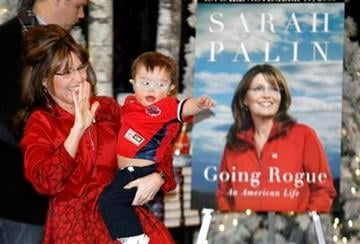 """Sarah Palin waves while holding her son Trig at a book signing for her new book """"Going Rouge"""" at the Mall of America in Bloomington, Minn. Dec. 7, 2009.  (AP Photo/Andy King) By Andy King"""