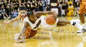Missouri's Zaire Taylor, right, steals the ball away from Texas's Dogus Balbay, left, during the first half of an NCAA college basketball game Wednesday, Feb. 17, 2010, in Columbia, Mo.(AP Photo/L.G. Patterson) By L.G. Patterson