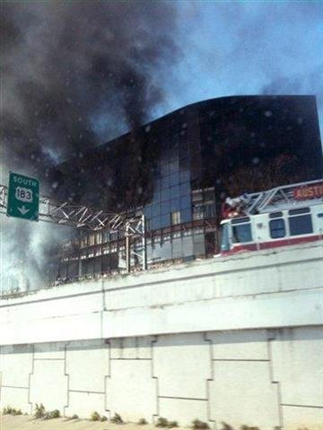 In this photo provided by Grant Abston, smoke billows from a seven-story building after a small private plane crashed into the building  in Austin, Texas on Thursday Feb. 18, 2010. (AP Photo/Courtesy Grant Abston) NO SALES By Grant Abston