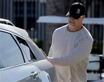St. Louis Cardinals hitting coach Mark McGwire closes the back of a car as he arrives for spring training baseball Wednesday, Feb. 17, 2010, in Jupiter, Fla. (AP Photo/Jeff Roberson) By Jeff Roberson