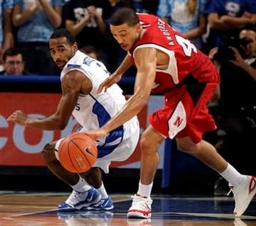 Nebraska's Ryan Anderson, right, takes a ball away from Saint Louis' Kwamain Mitchell, left, during the first half of an NCAA college basketball game Wednesday, Nov. 18, 2009, in St. Louis. (AP Photo/Jeff Roberson) By Jeff Roberson