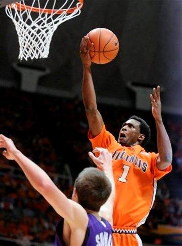 Illinois' D.J. Richardson (1) goes up for a shot against Northwestern's John Shurna during the first half of an NCAA college basketball game Thursday, Jan. 6, 2011, in Champaign, Ill. (AP Photo/Heather Coit) By Heather Coit