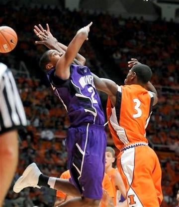 The ball gets away from Northwestern's Jershon Cobb (23) and Illinois' Brandon Paul (3) during the second half of an NCAA college basketball game Thursday, Jan. 6, 2011, in Champaign, Ill. Illinois won 88-63. (AP Photo/Heather Coit) By Heather Coit