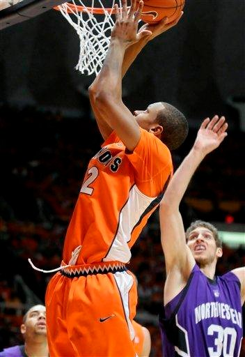 Illinois' Jereme Richmond (22) goes up for a basket against Northwestern's Davide Curletti (30) during the first half of an NCAA college basketball game Thursday, Jan. 6, 2011, in Champaign, Ill. (AP Photo/Heather Coit) By Heather Coit