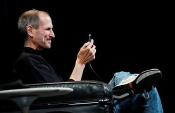 Apple CEO Steve Jobs smiles as he uses the new iPhone 4 at the Apple Worldwide Developers Conference, Monday, June 7, 2010, in San Francisco. (AP Photo/Paul Sakuma) By Paul Sakuma