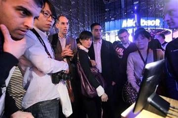 Buyers at the Consumer Electronics Show examine Motorola's new Xoom tablet, Thursday, Jan. 6, 2011 in Las Vegas. (AP Photo/Julie Jacobson) By Julie Jacobson