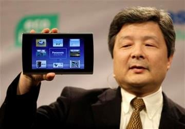 Shiro Kitajima, president of the Panasonic Consumer Electronics Company, holds up a Viera Tablet during a press preview for the Consumer Electronics Show Wednesday, Jan. 5, 2011 in Las Vegas. (AP Photo/Julie Jacobson) By Julie Jacobson