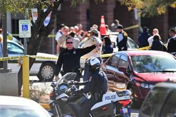 Emergency workers gather at the scene of a shooting involving Rep. Gabrielle Giffords, D-Ariz., Saturday, Jan. 8, 2011, at a Safeway grocery store in Tucson, Ariz.  (AP Photo/Chris Morrison) By Chris Morrison
