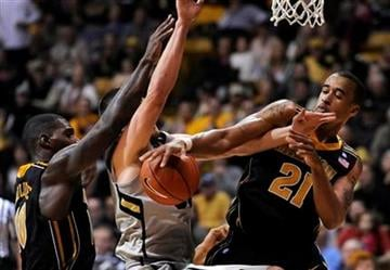Missouri forward Laurence Bowers (21) swats down a shot by Colorado forward Austin Dufault (33) during the second half of an NCAA college basketball game, Saturday, Jan. 8, 2011, in Boulder, Colo. (AP Photo/Jack Dempsey) By Jack Dempsey