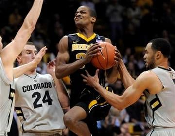 Missouri guard Kim English (24) goes up between Colorado guard Levi Knutson (24) and Marcus Relphorde (5) during the first half of an NCAA college basketball game, Saturday, Jan. 8, 2011, in Boulder, Colo. (AP Photo/Jack Dempsey) By Jack Dempsey
