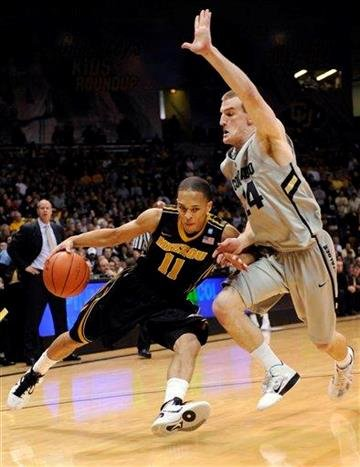Missouri guard Matt Pressey (3) drives past Colorado guard Javon Coney (14) during the first half of an NCAA college basketball game, Saturday, Jan. 8, 2011, in Boulder, Colo. (AP Photo/Jack Dempsey) By Jack Dempsey