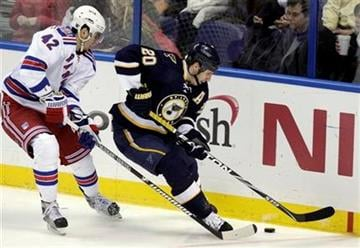 St. Louis Blues' Alexander Steen (20) keeps the puck away from New York Rangers' Artem Anisimov (42) in the third period of an NHL hockey game, Saturday, Jan. 8, 2011 in St. Louis. The Rangers beat the Blues 2-1.(AP Photo/Tom Gannam) By Tom Gannam